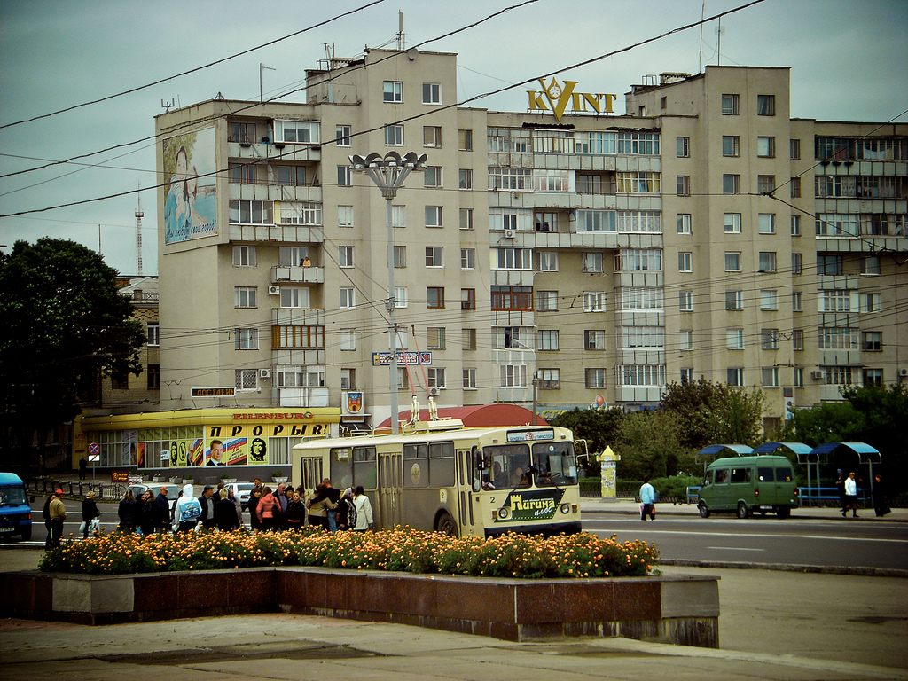 The cityscape is typically Sovjet style