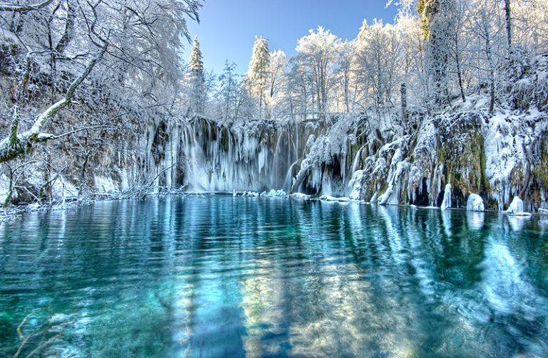 Winter landscape with snow-covered trees around Plitvice Lakes